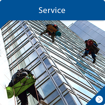 Window cleaners on a tall glass building